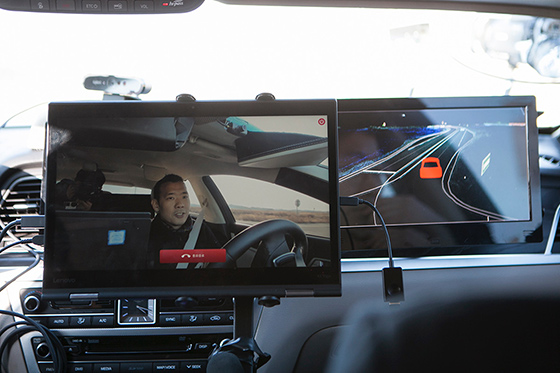 Screens of 5G video call and HD map that were mounted inside a self-driving car